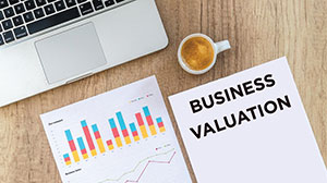 image of papers with chart and text: business valuation