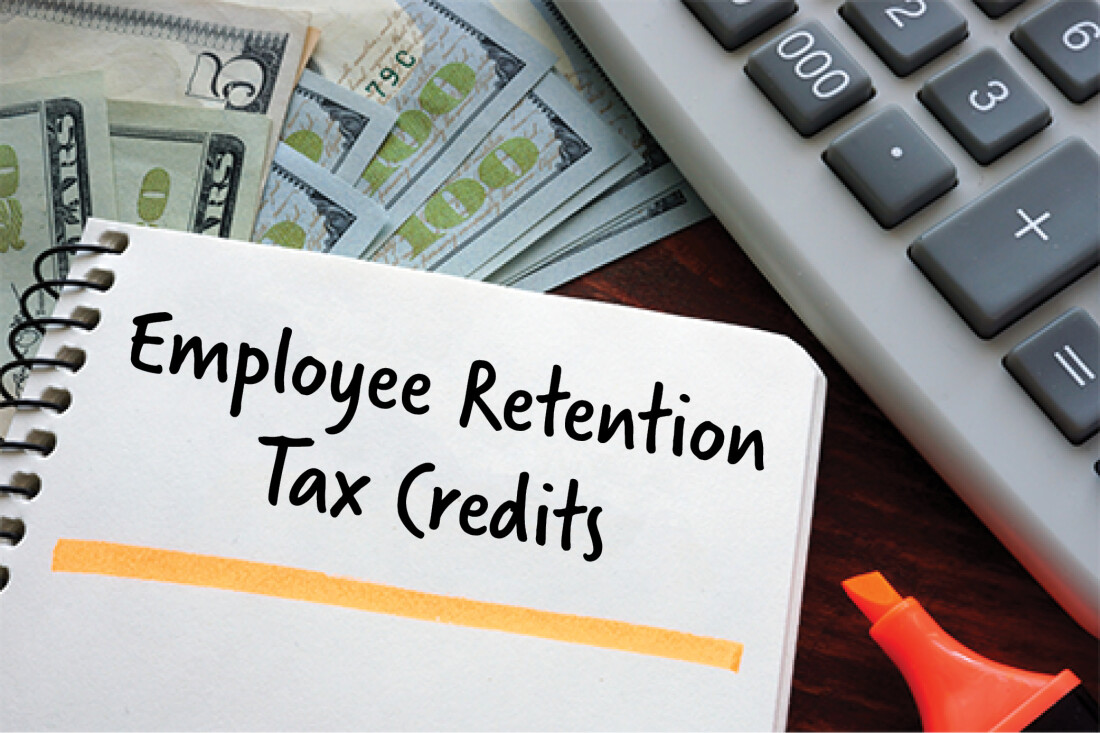 image of calculator, cash, and notebook with text: employee retention tax credits