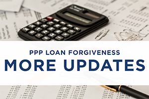 image of tax papers with text PPP loan forgiveness more updates