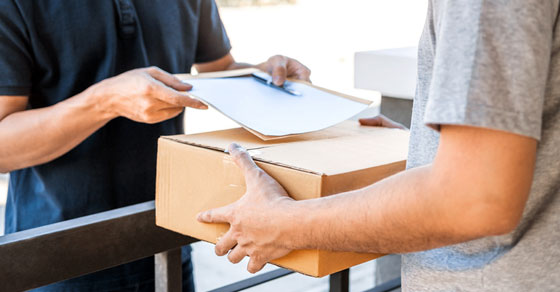 image of man signing for package